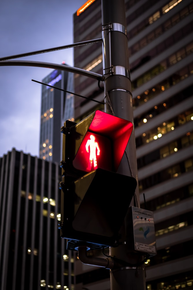 red man at a traffic signal. showing you should stop and not jaywalk