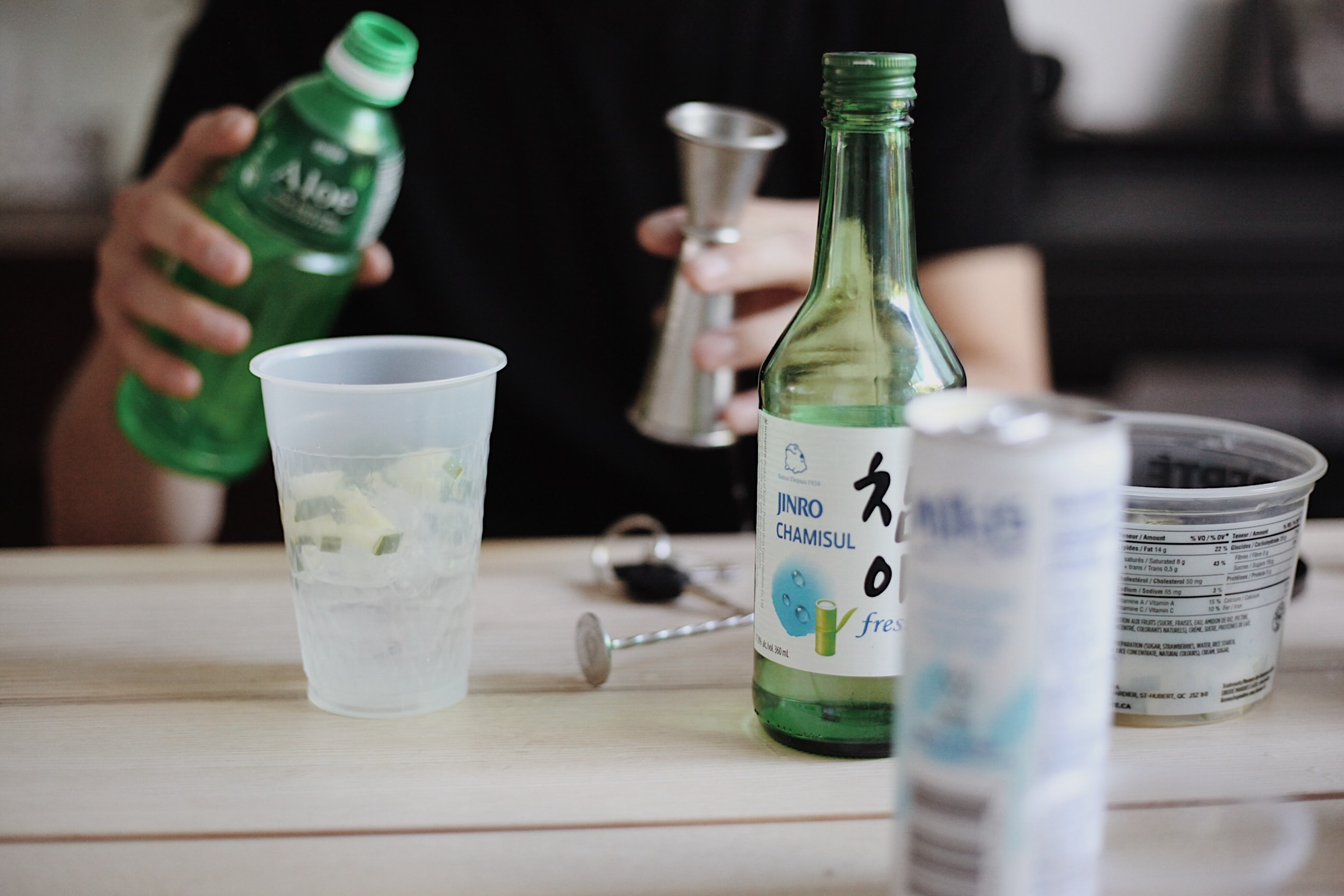 Korean person pouring soju