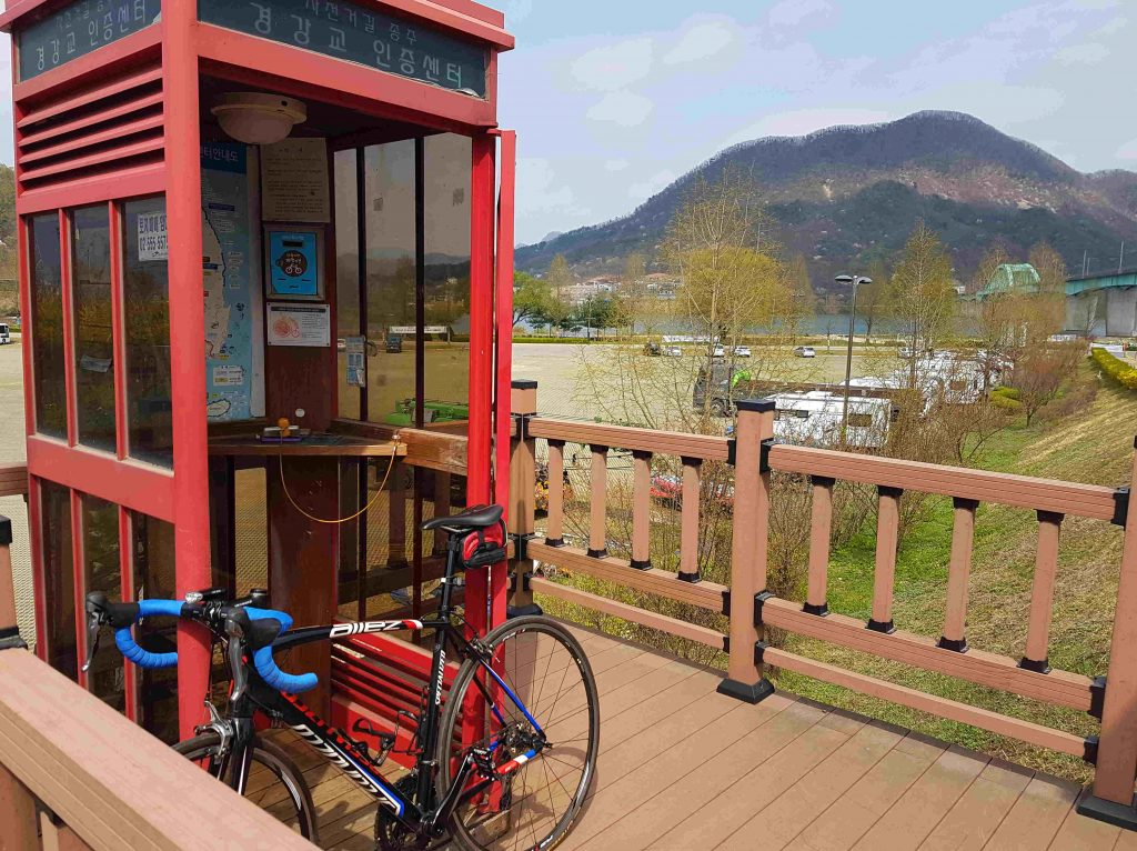 When you are cycling in korea you can see red telephone booths like the one shown in the picture