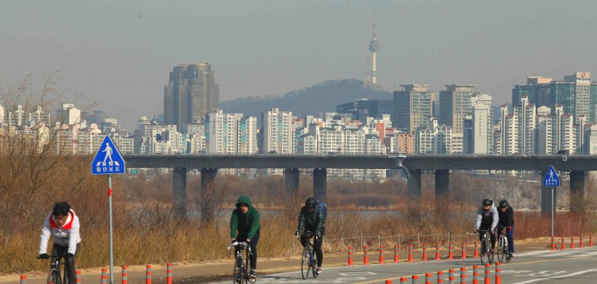 The Seoul skyline from Yeouido Island shows Namsan tower in the background.