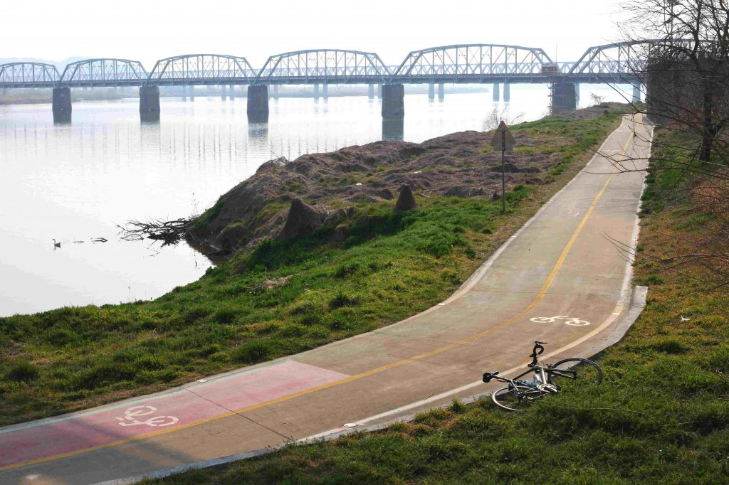 A bike lays near the designated bike path. Near the southern Korean town of  Samnangjin. The bike was traveling in korea to the next town of Samnagjiin.