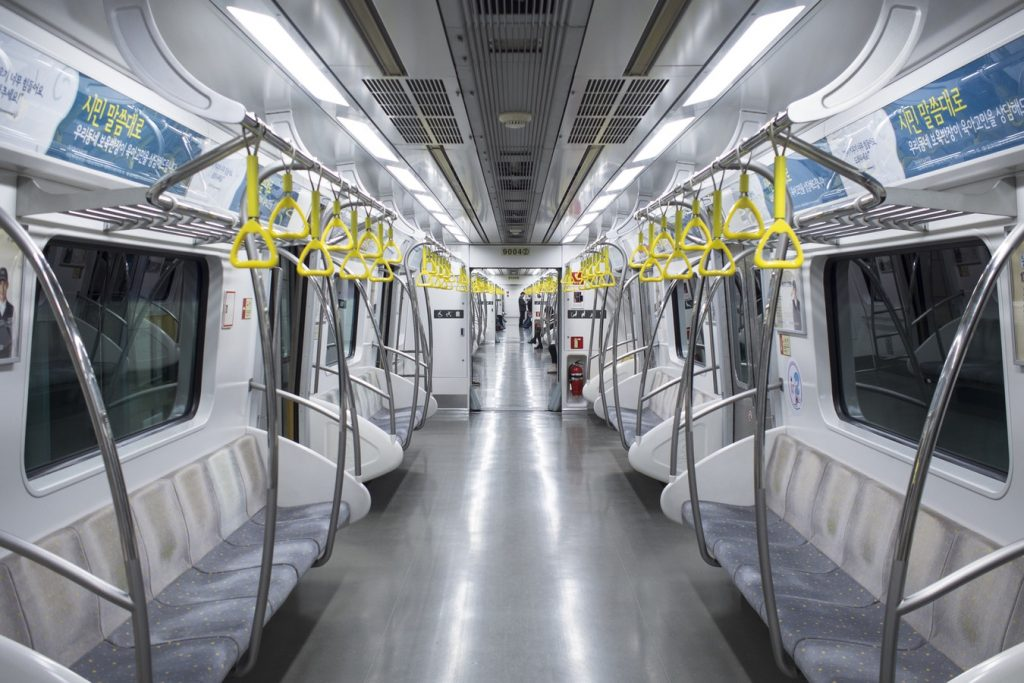 An interior picture of an empty Seoul subway car.