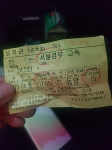 Korea travel bus ticket with the destination, departure time, and platform circled.