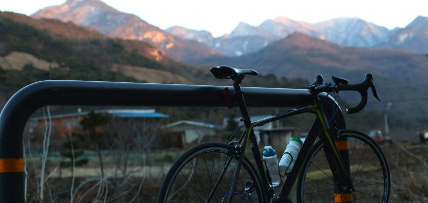 A bike sits in front of a set of mountains near Mungyeong.