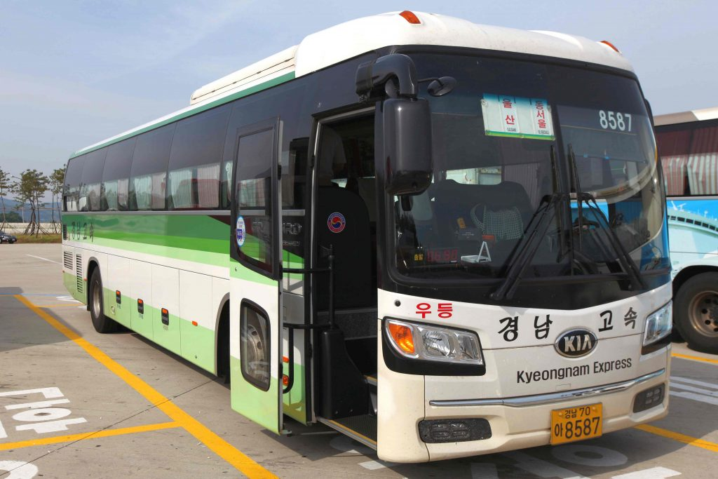 A premium intercity bus equipped with WiFi and charging ports.
