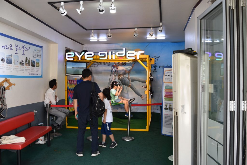 A virtual reality shop in incheon chinatown. Children are playing on the machine