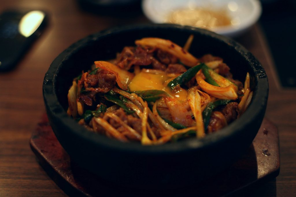 A pot of meat bibimbap (비빔밥). Don't touch the stone pot! It's still sizzling hot.
