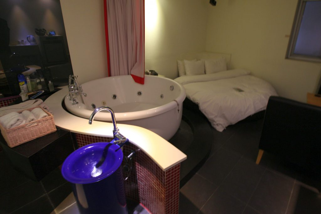 A standard motel room in Hanam city in outside of Seoul. The Jacuzzi is larger than the bed.