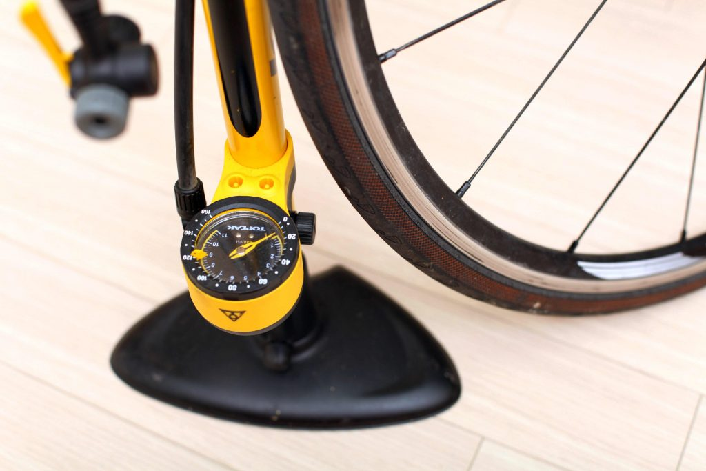 A picture of a floor bike pump to which should be on your bike maintenance checklist