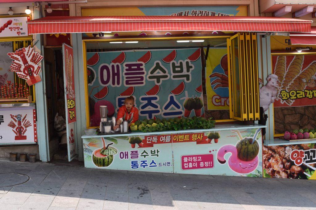 Korean street food. This shop is selling watermelons.