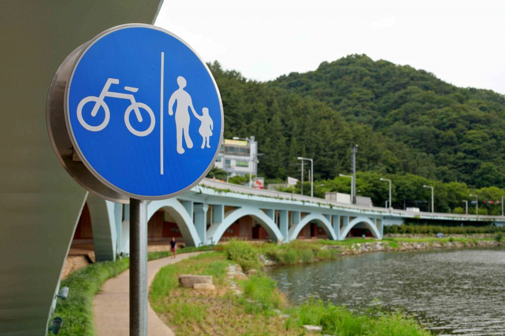 A road sign on the bike paths that show pedestrian and bikers are allowed on the same path.
