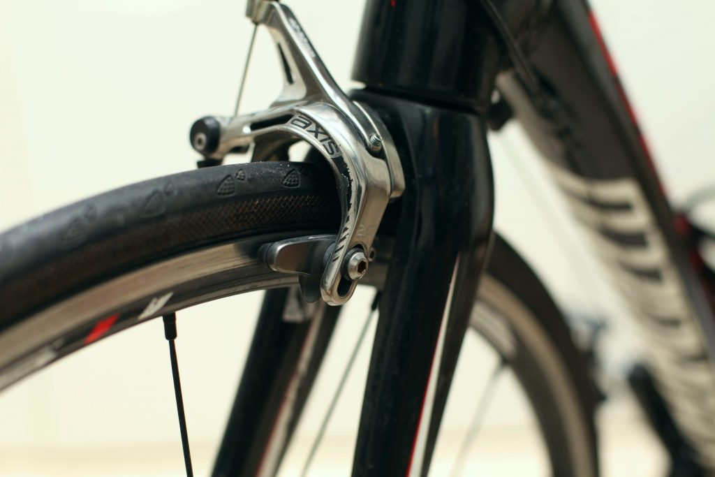 A photo of rim brakes on a bicycle.