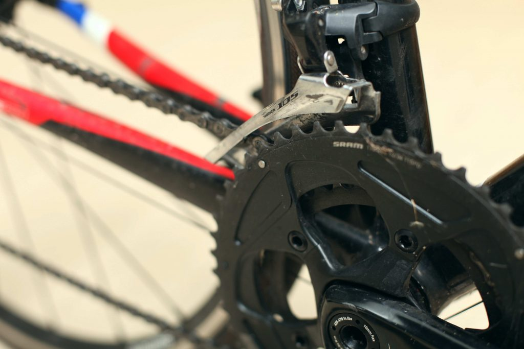 A photo of a front derailleur on a bike.