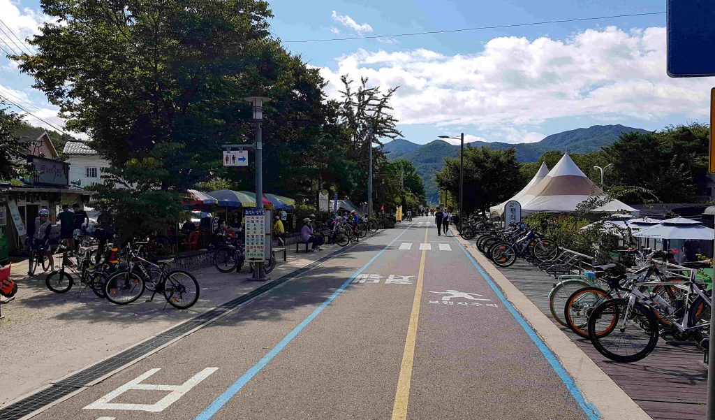 A view of Neungnae Station. Bikers rest at the local shops.