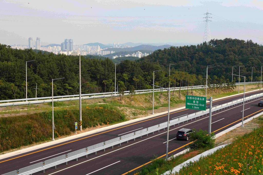 A highway in Korea. You can see the city of Ulsan in the background.