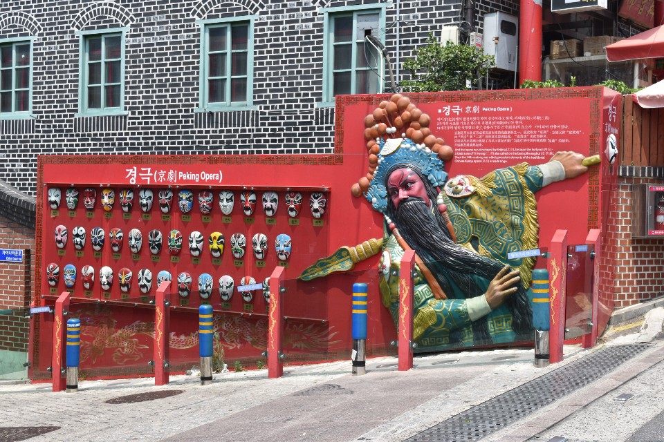 A photo of the red pecking opera wall display in Incheon Chinatown