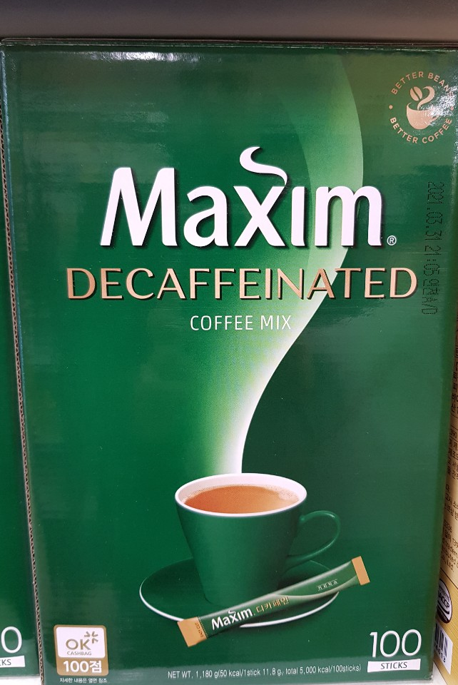 A box of maxim decaffeinated instant coffee mix