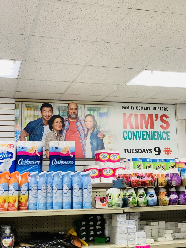 A photo of the inside of Kim's Convenience Store showing an advertisement for the show on the wall.