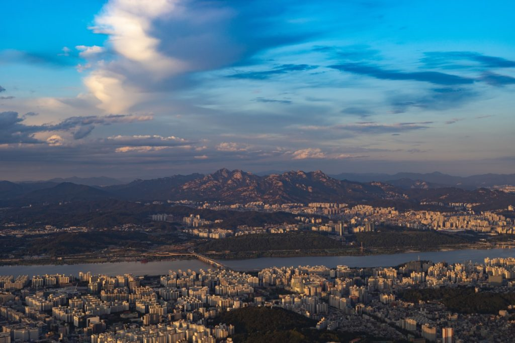 A photo of seoul with Bukhansan mountain in the background