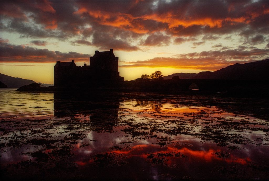A photo of a fort with a red sky in the background