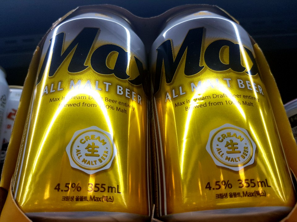 a photo of max beer cans