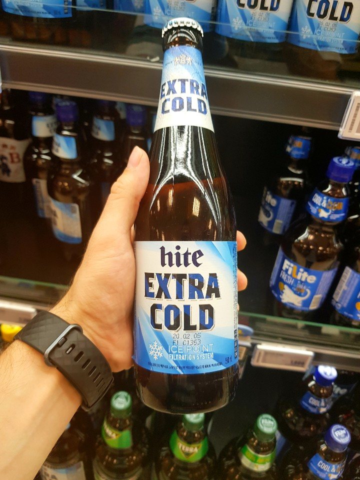 A photo of a hite extra cold beer bottle