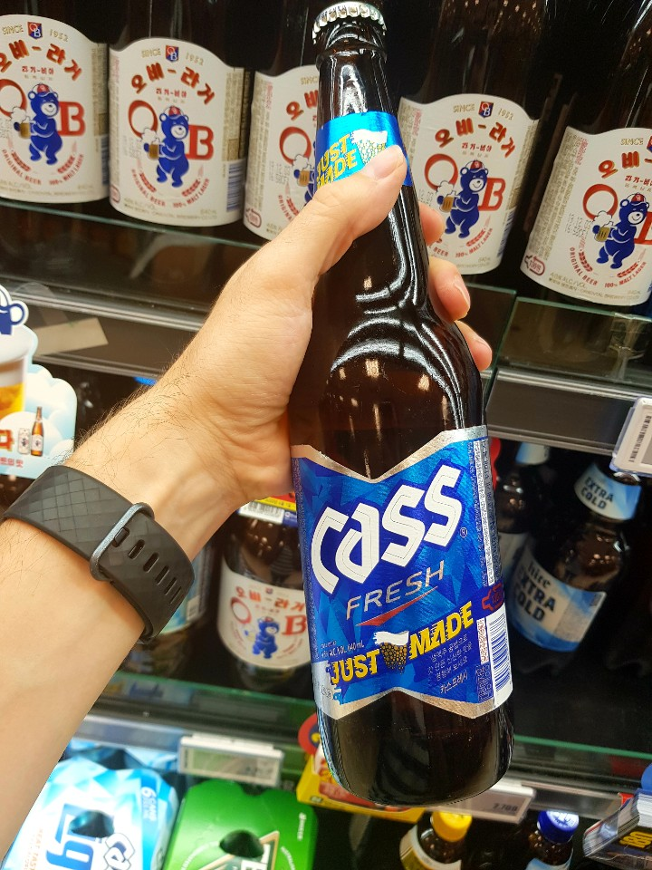 A photo of one ass beer bottle