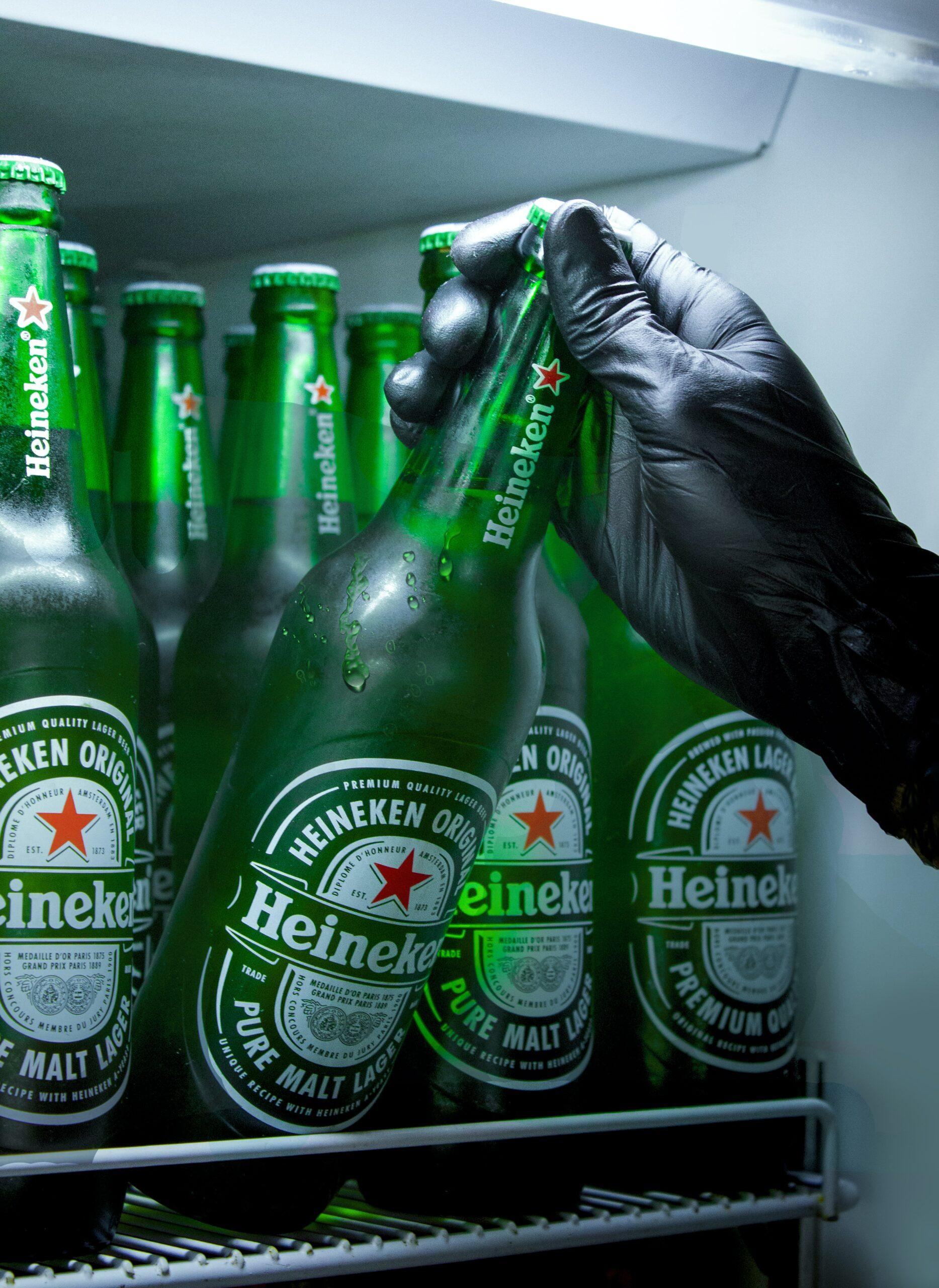 A photo of Heineken beer bottles in the fridge