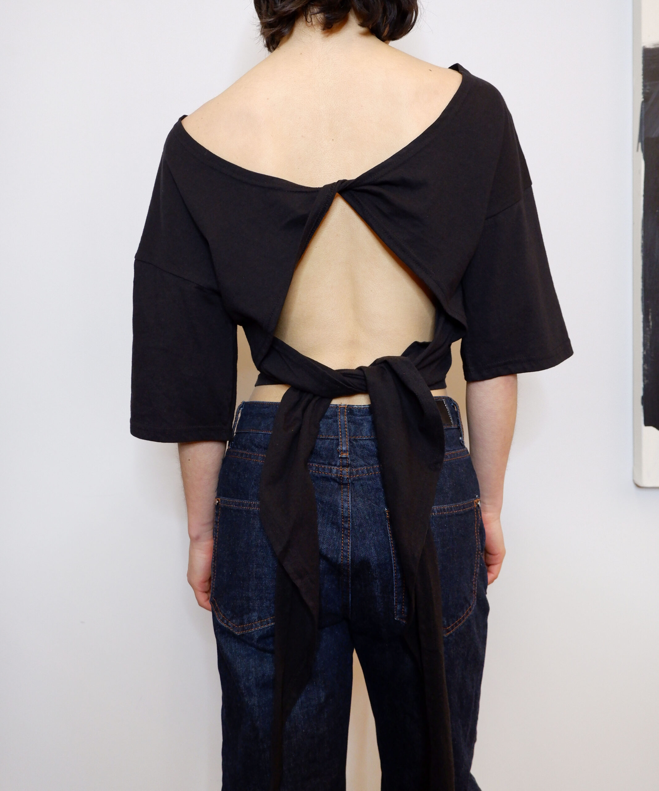 Open-back ribbon tie cropped t-shirt in black | The Dallant | Korean fashion online shopping site